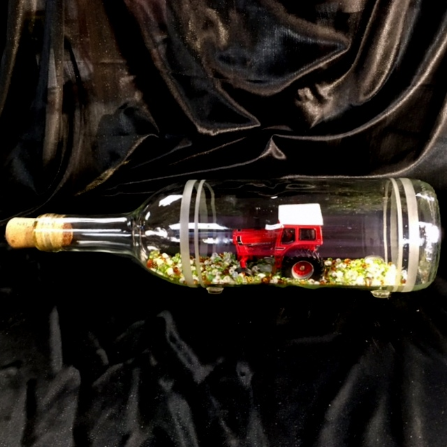 International Harvester red tractor in a bottle