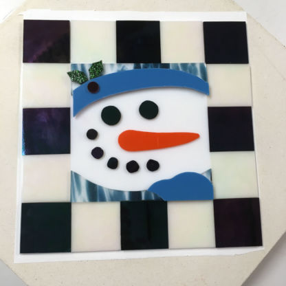 Fused snowman cookie tray before firing.
