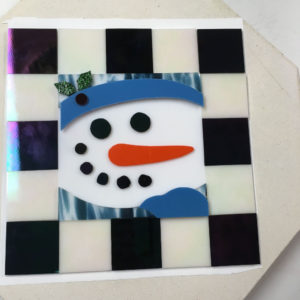 Fused snowman cookie tray before kiln firing